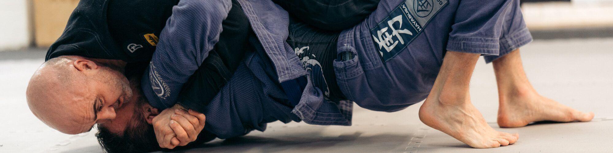 greg and roo head and arm 1999x500 - Brazilian Jiu Jitsu